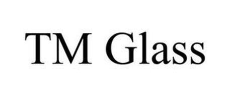T.M. GLASS